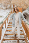 Piper & Scoot: The Bianca Cinch Velvet Jumpsuit in Beige, lifestyle shoot; front view paired with cardigan