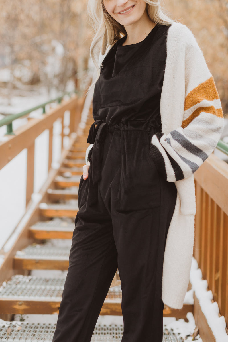 Piper & Scoot: The Bianca Cinch Velvet Jumpsuit in Black, lifestyle shoot; front view