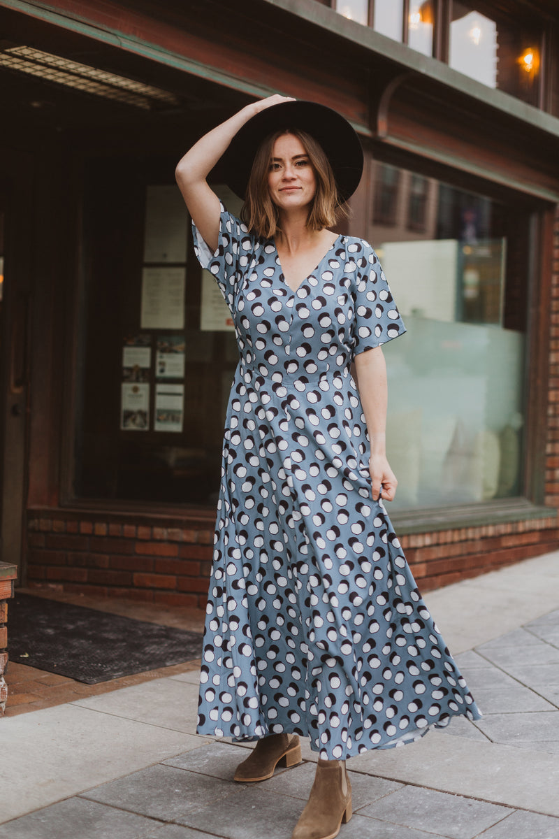 The Lively Patterned Maxi Dress in Blue, lifestyle shoot; front view