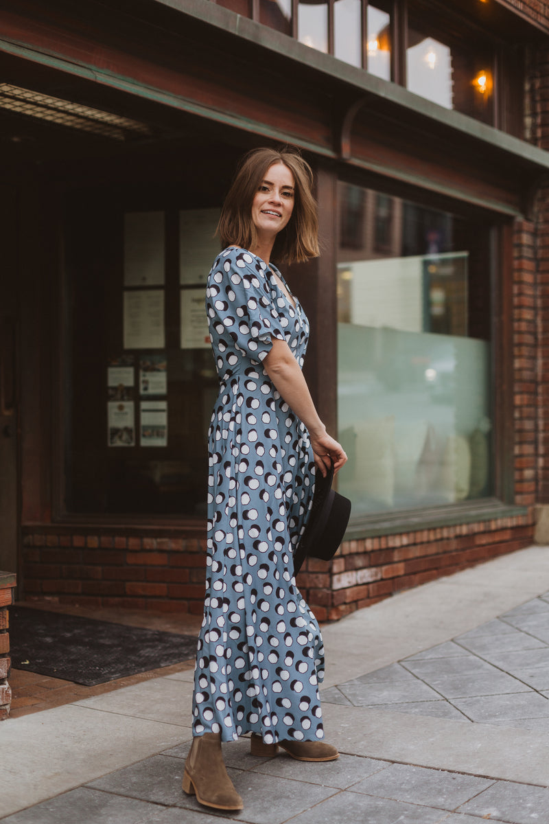 The Lively Patterned Maxi Dress in Blue, lifestyle shoot; side view