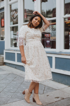 The Illusion Floral Delicate Lace Dress in Ivory, lifestyle shoot; front view