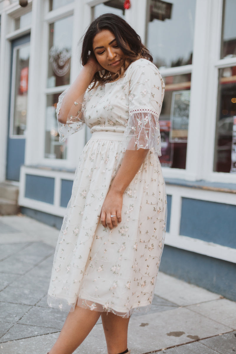 The Illusion Floral Delicate Lace Dress in Ivory, lifestyle shoot; side view