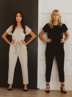 Piper & Scoot: The Bianca Cinch Velvet Jumpsuit in Black, studio shoot; front view side by side with beige bianca