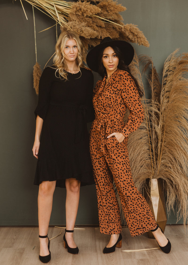 The Alter Collared Animal Print Jumpsuit in Camel, studio shoot; front view paired with friend