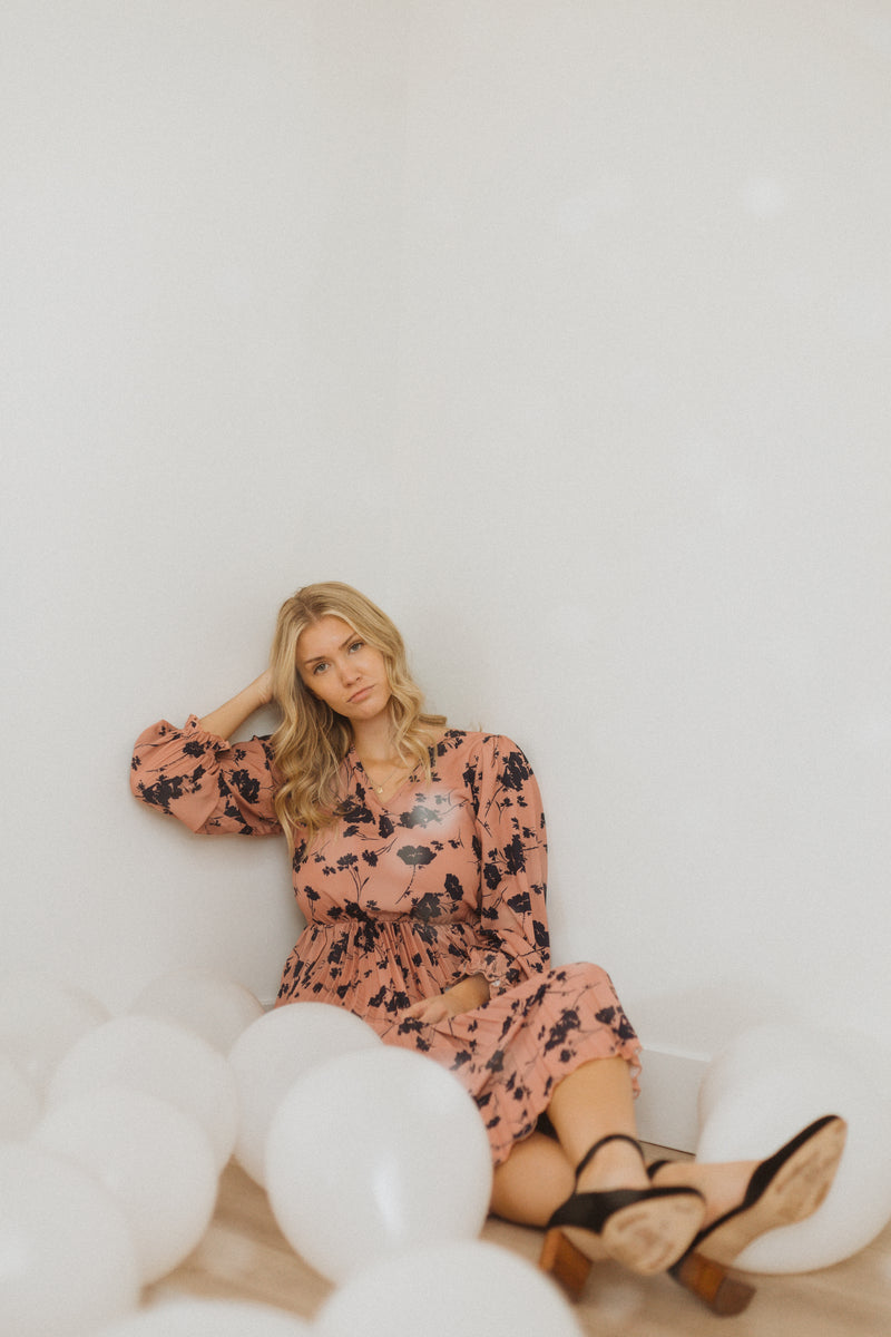 Piper & Scoot: The Stargaze Floral Flare Dress in Rose, studio shoot; seated front view styled with balloons