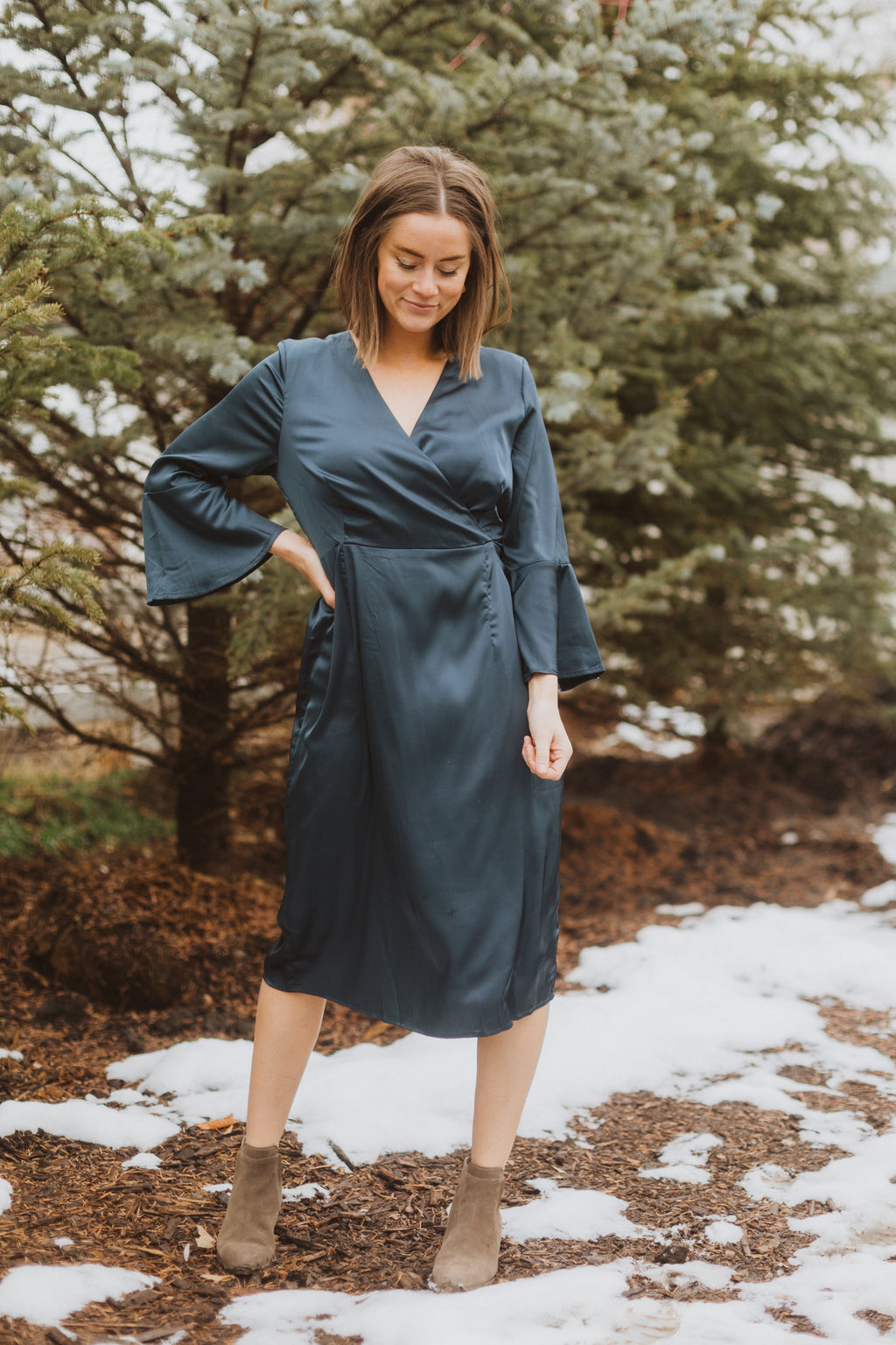 The Tull Satin Flare Sleeve Dress in Stone, lifestyle shoot; front view