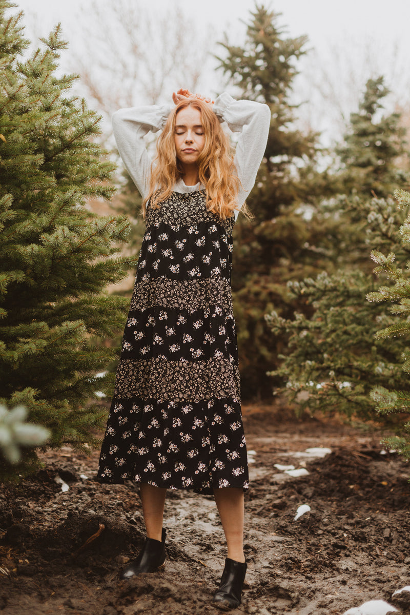 The Walter Tiered Floral Maxi Dress in Black, lifestyle shoot; front view