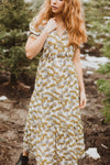 The Jackman Floral Tiered Dress in Cream, lifestyle shoot; front view