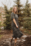 Piper & Scoot: The Ultimate Lace Detail Dress In Charcoal, lifestyle shoot; side view
