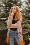 The Walcott Striped Cozy Cardigan in Blush Multi, lifestyle shoot; front view