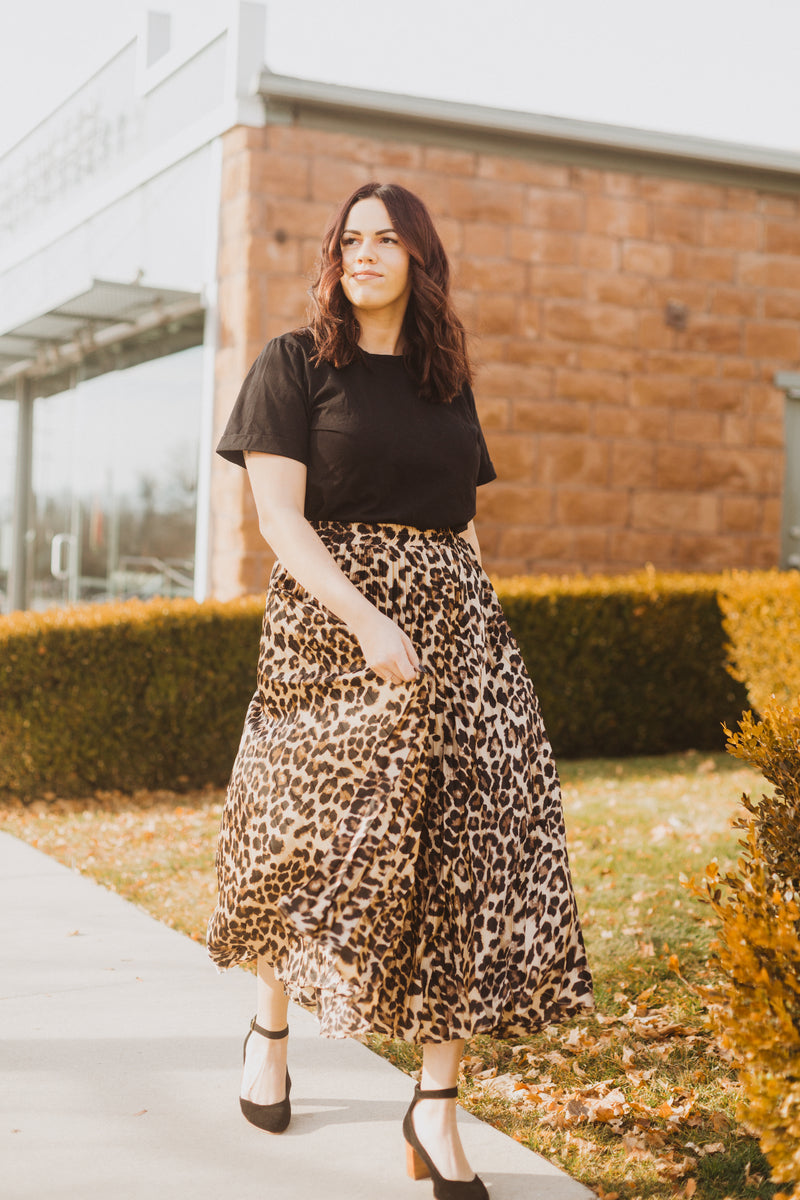 The Rebekah Pleated Leopard Midi Skirt, lifestyle shoot; front view