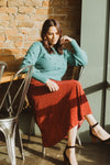 The Fran Patterned Midi Skirt in Red, lifestyle shoot; sitting front view