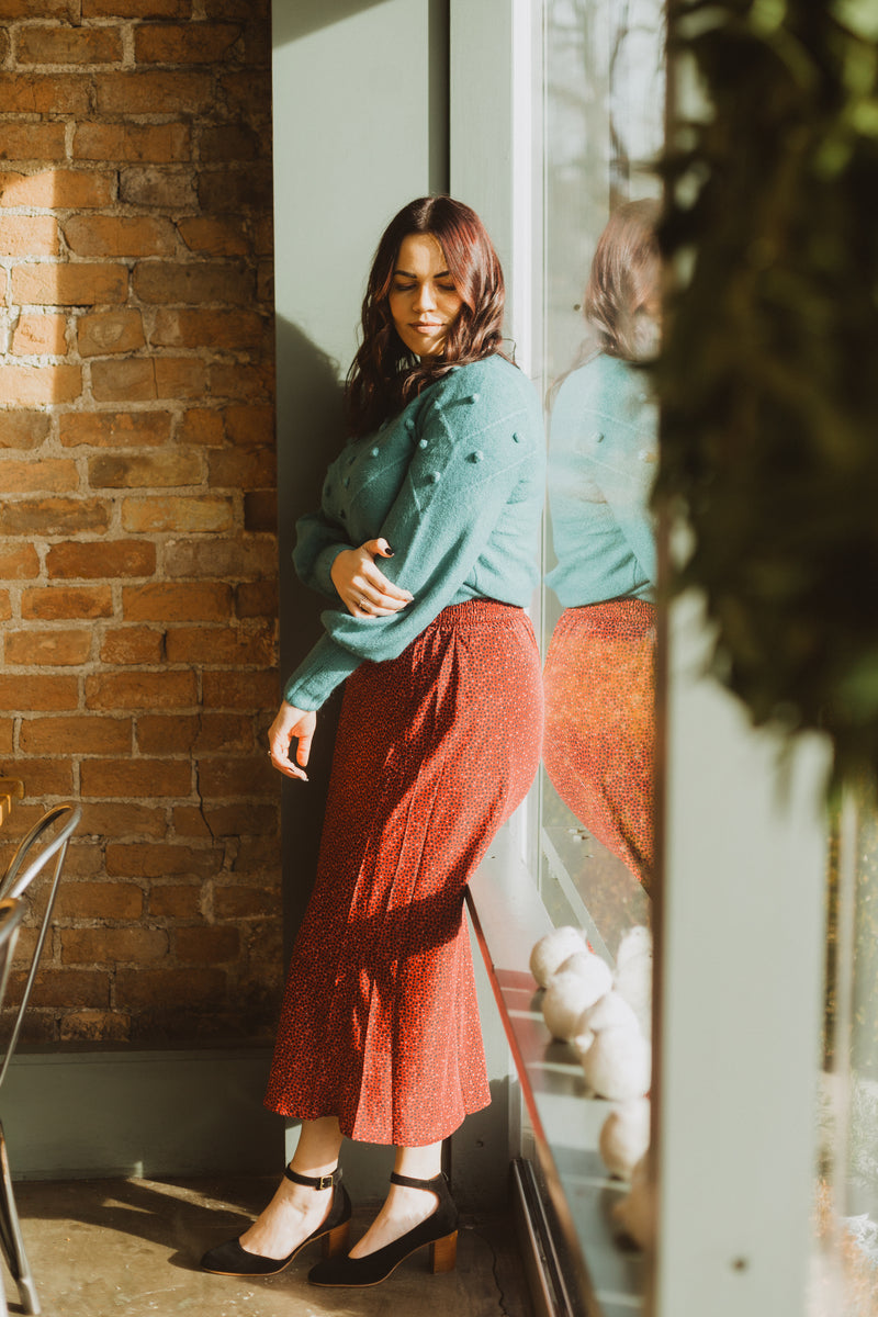 The Fran Patterned Midi Skirt in Red, lifestyle shoot; front view