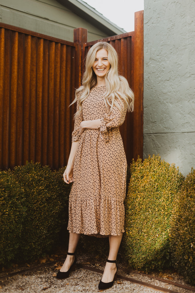 The Elena Patterned Tiered Dress in Nude, lifestyle shoot; front view
