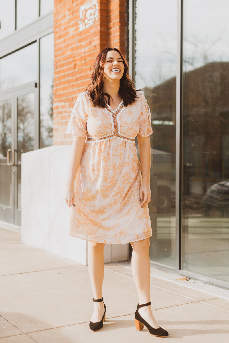 Piper & Scoot: The Kenley Detail Empire Dress in Peach, lifestyle shoot; front view