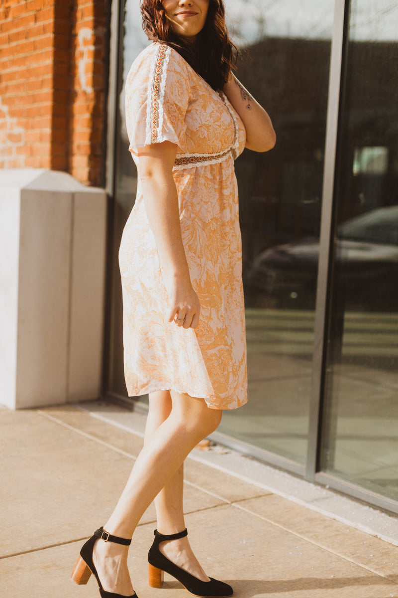 Piper & Scoot: The Kenley Detail Empire Dress in Peach, lifestyle shoot; side view