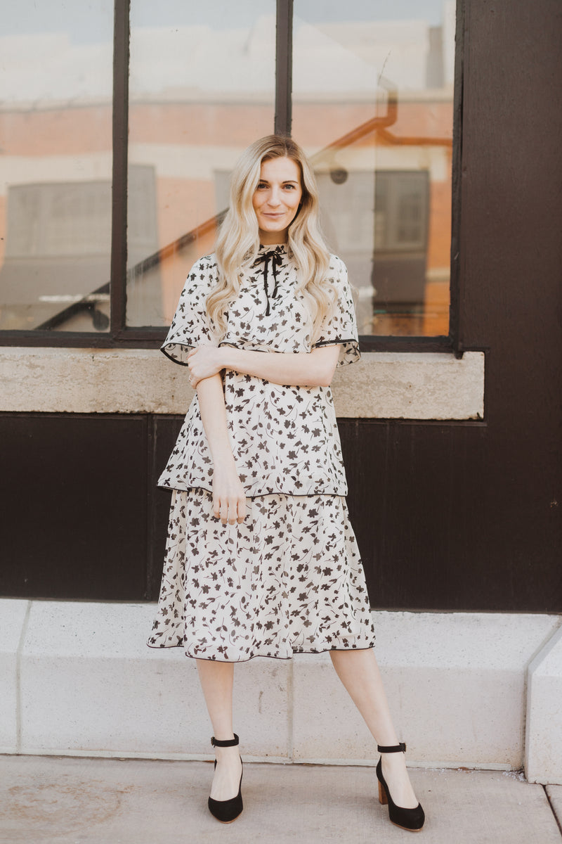 Piper & Scoot: The Helen Tiered Patterned Dress in Ivory, lifestyle shoot; front view