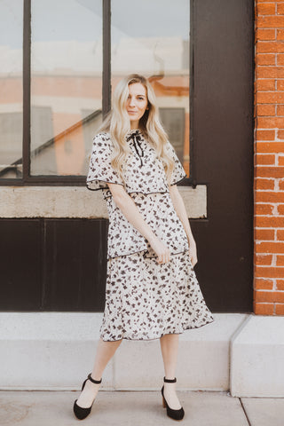The Elena Patterned Tiered Dress in Taupe