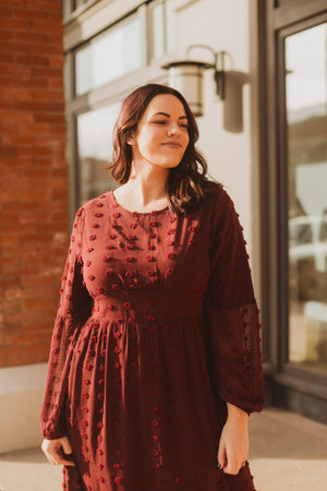 Piper & Scoot: The Jane Swiss Dot Empire Dress in Burgundy, lifestyle shoot; front view