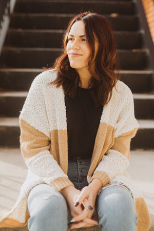 The Annelle Block Cardigan in Tan, lifestyle shoot; front view