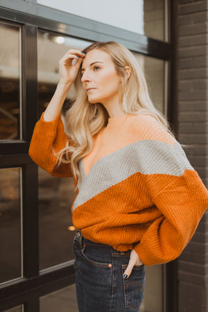 The Arianna V Sweater in Camel Multi, lifestyle shoot; side view
