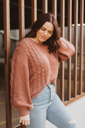 The Wanda Knit Sweater in Clay, lifestyle shoot; side view