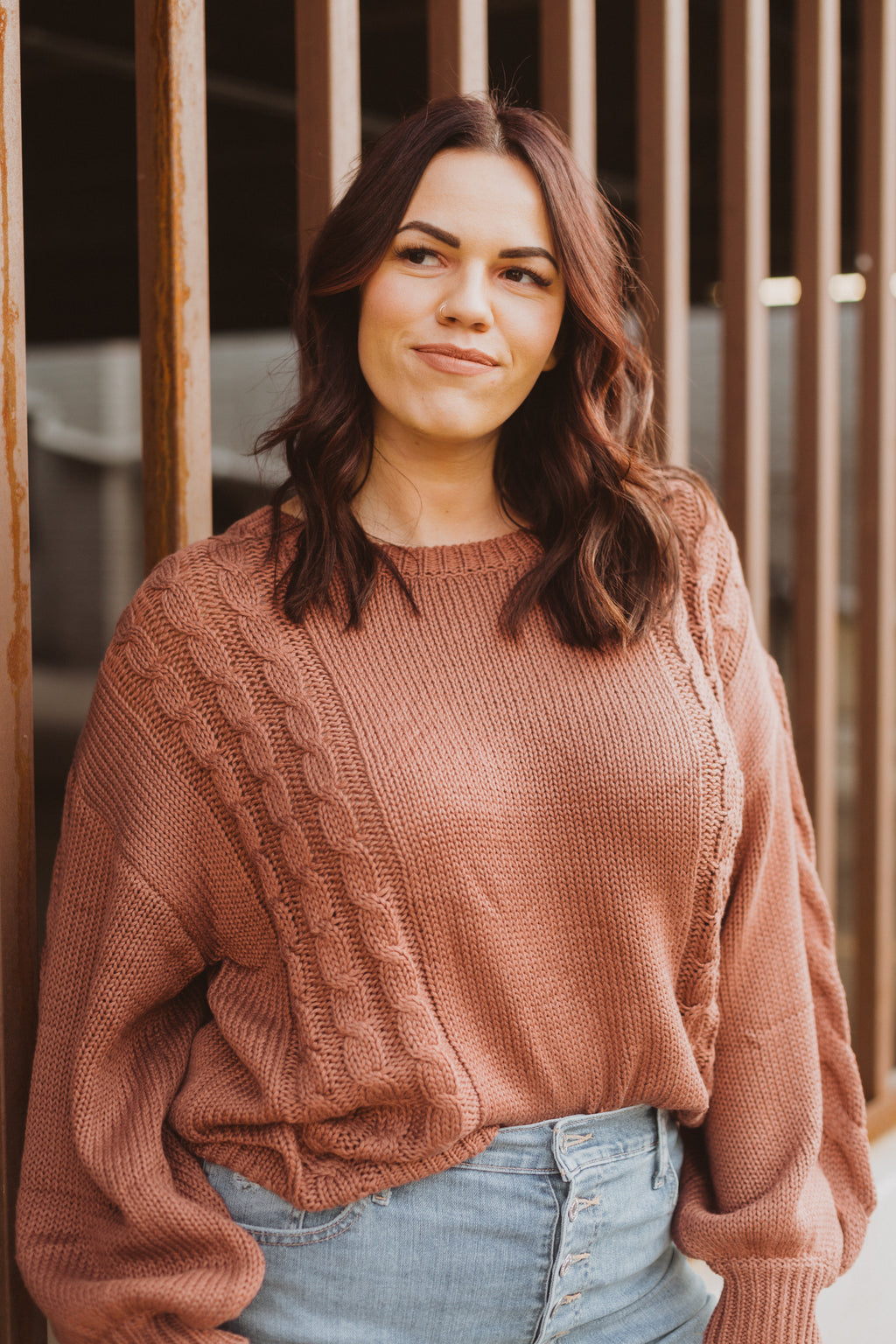 The Wanda Knit Sweater in Clay, lifestyle shoot; front view
