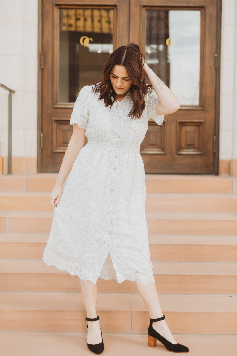 The Givell Floral Detail Dress in Ivory, lifestyle shoot; front view