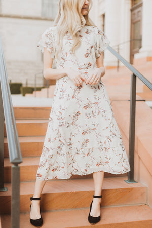 Piper & Scoot: The Mildred Floral Empire Dress in Cream, lifestyle shoot; front view
