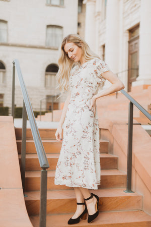 Piper & Scoot: The Mildred Floral Empire Dress in Cream, lifestyle shoot; side view
