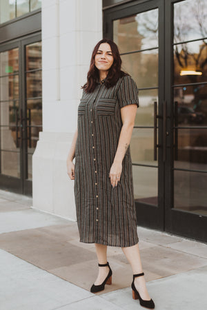Piper & Scoot: The Wimm Striped Button Dress in Black, lifestyle shoot; front view