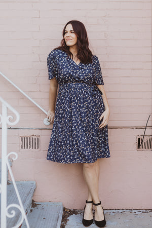 Piper & Scoot: The Marleigh Floral Wrap Dress in Navy, lifestyle shoot; front view