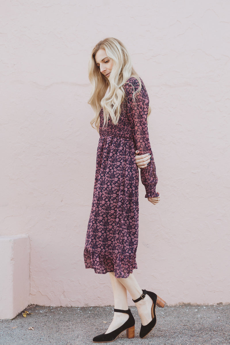 Piper & Scoot: The Emery Smocked Floral Dress in Navy + Rose, lifestyle shoot; side view