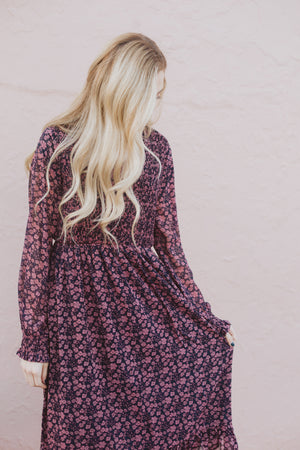 Piper & Scoot: The Emery Smocked Floral Dress in Navy + Rose, lifestyle shoot; front view