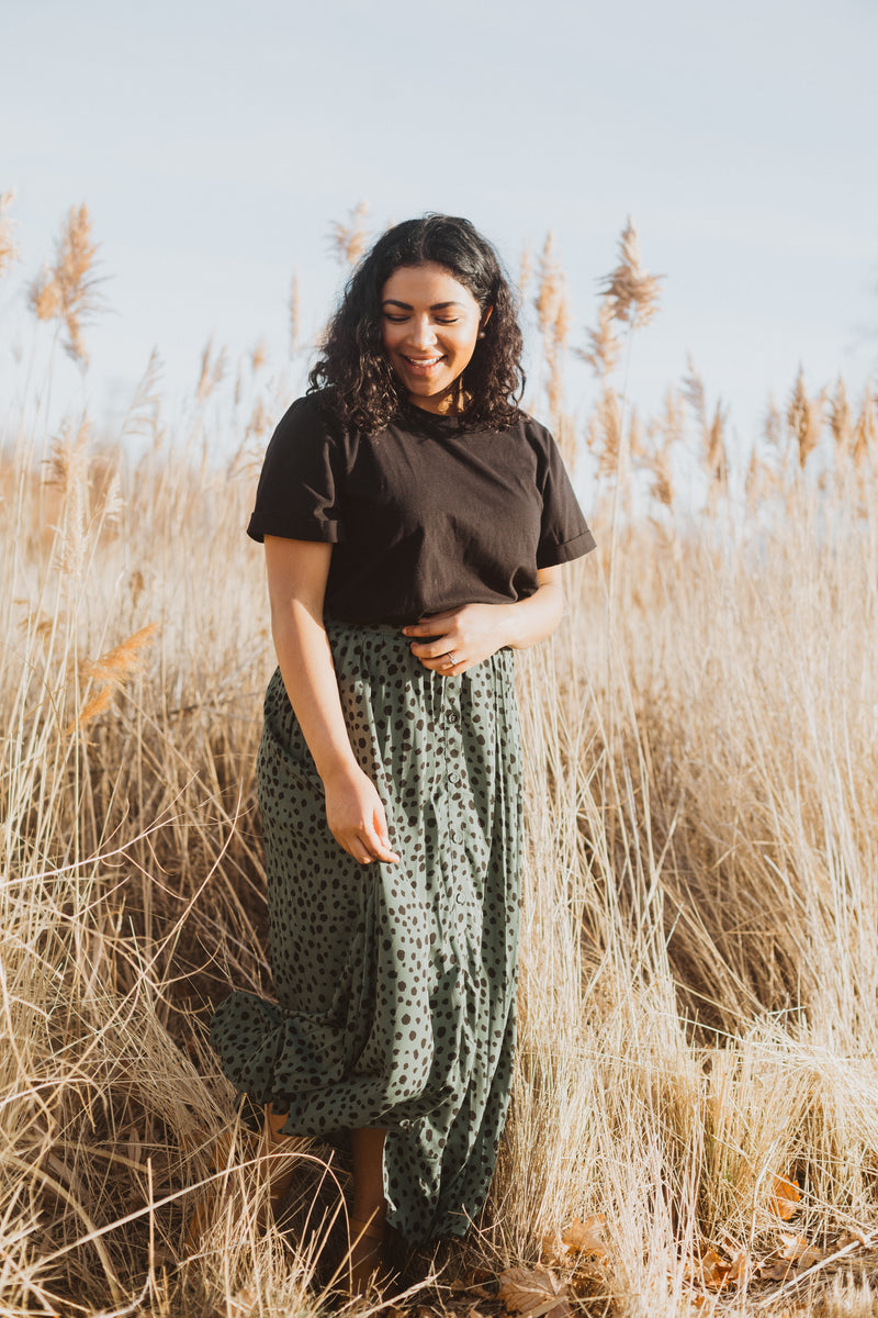 The Fletcher Dot Midi Skirt in Green, lifestyle shoot; front view