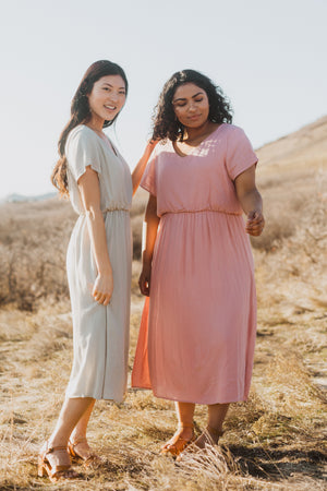 The Derby Dress in Blush, lifestyle shoot; front view paired with friend