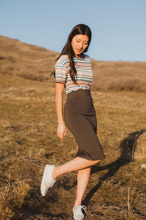 The Ponte Pencil Skirt in Charcoal, lifestyle shoot; front view