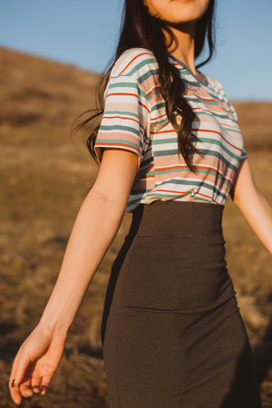 The Ponte Pencil Skirt in Charcoal, lifestyle shoot; side view