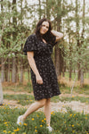 , The Heidi Floral Neck Tie Dress in Black, lifestyle shoot; side view