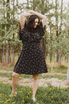 , The Heidi Floral Neck Tie Dress in Black, lifestyle shoot; front view