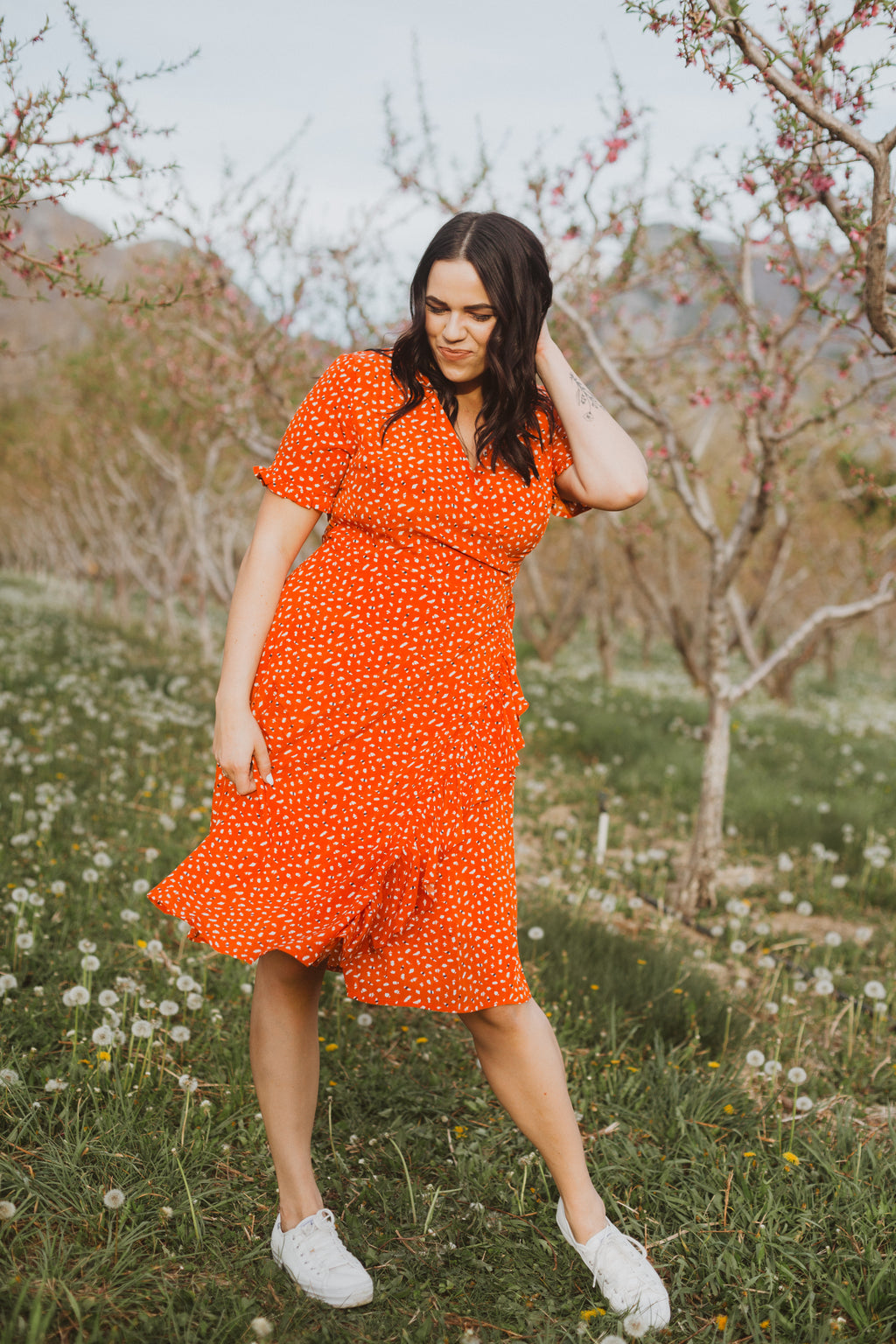 The Phoebe Patterned Ruffle Wrap Dress in Poppy