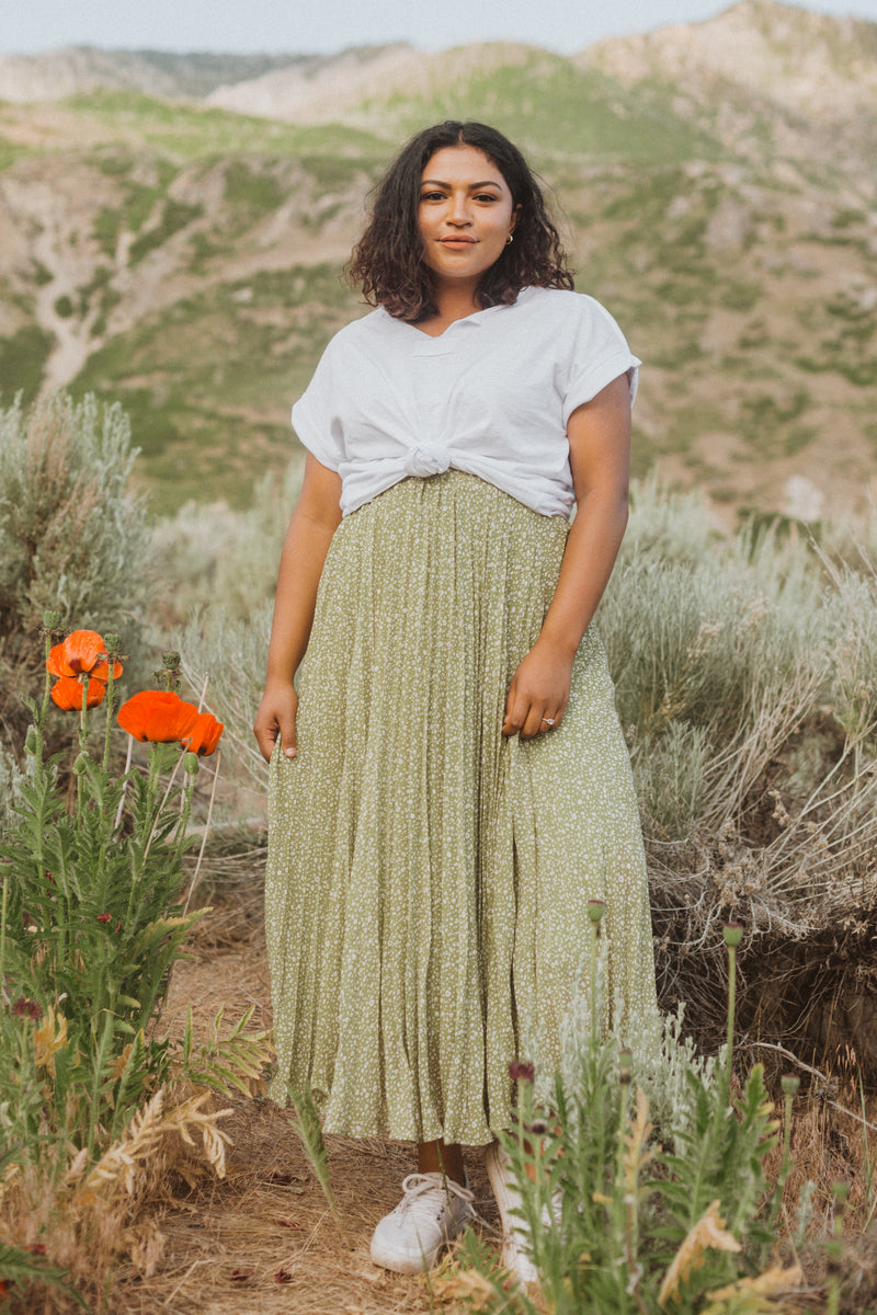 The Gibson Patterned Pleated Maxi Skirt in Dusty Green, lifestyle shoot; front view