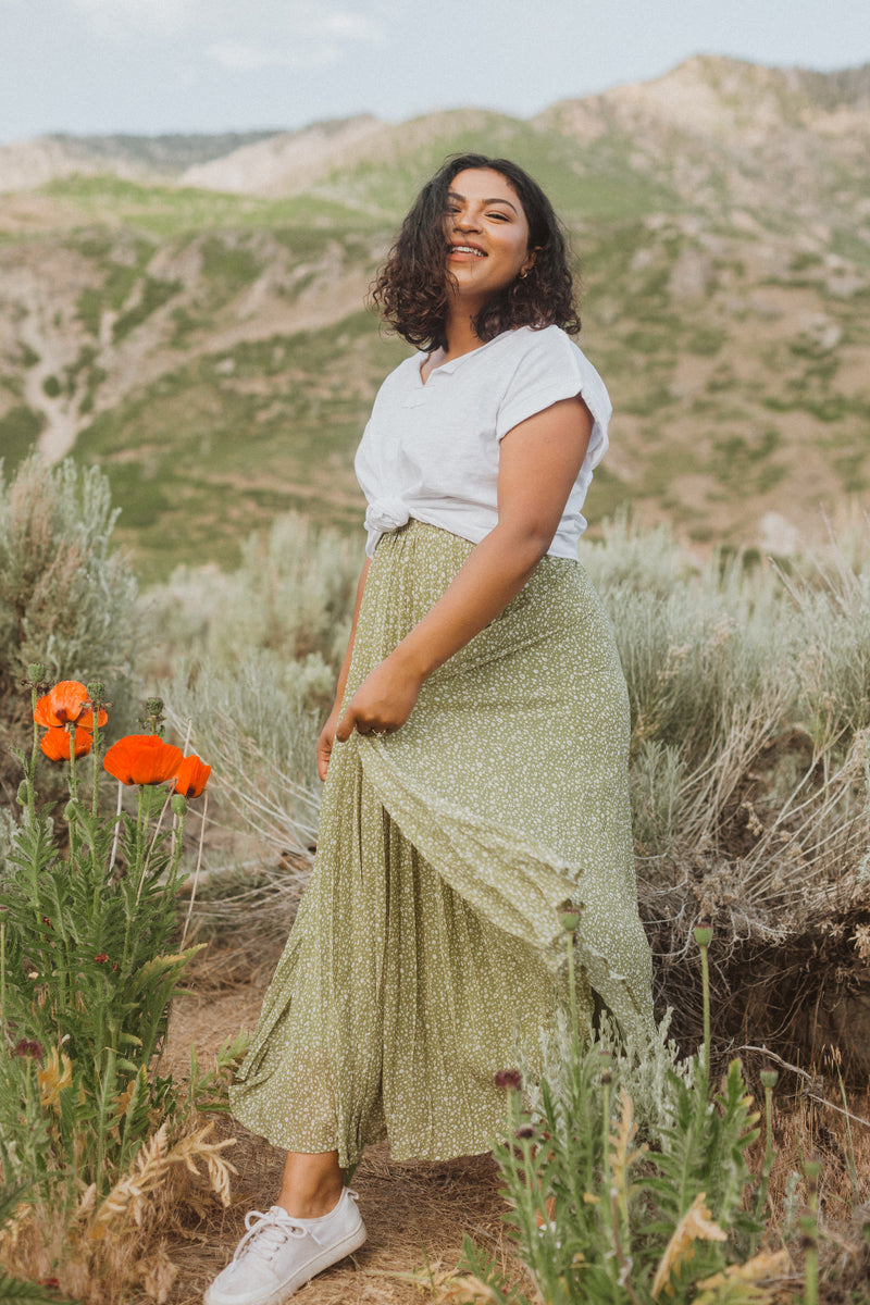 The Gibson Patterned Pleated Maxi Skirt in Dusty Green, lifestyle shoot; side view