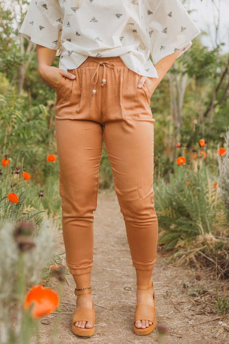 The Denver Tapered Trousers in Faded Brick, lifestyle shoot; front view