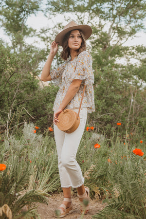,The Billy Sheer Floral Tiered Blouse in Taupe, lifestyle shoot; side view