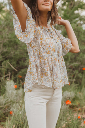 ,The Billy Sheer Floral Tiered Blouse in Taupe, lifestyle shoot; front view