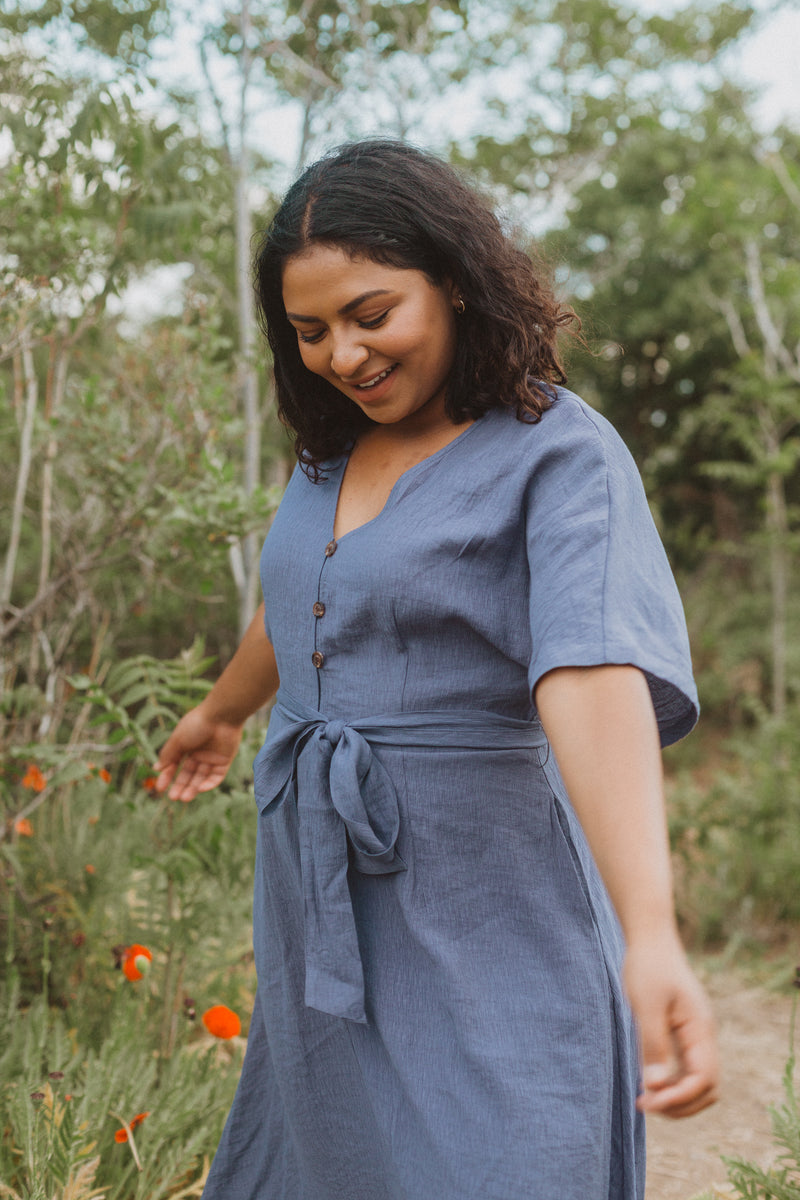The Benton Button Midi Dress in Indigo, lifestyle shoot; front view