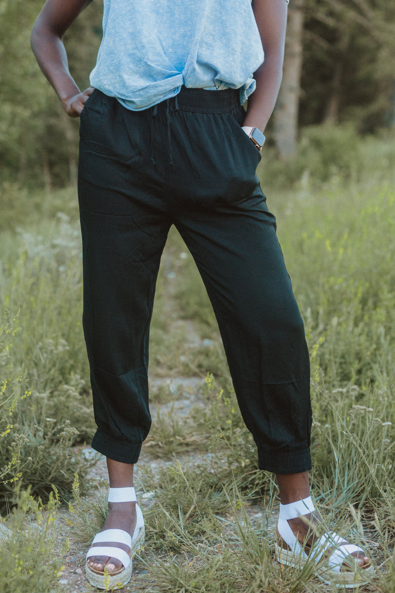 The Axel Jogger Trouser in Black, lifestyle shoot; front view