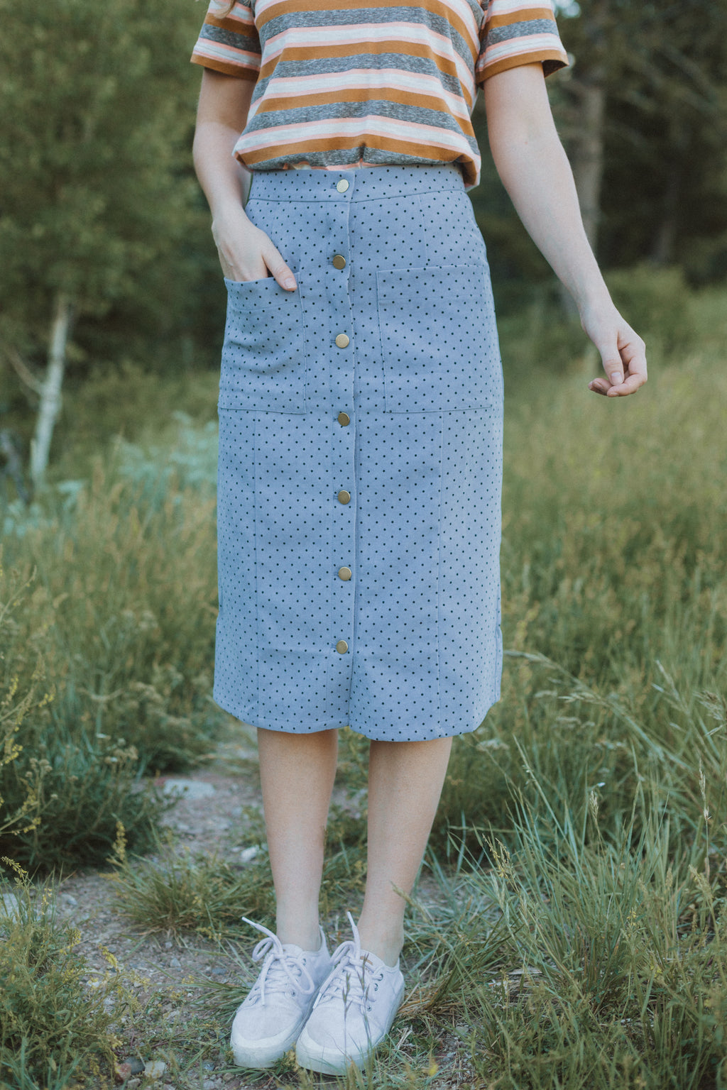 The Jason Dot Button Skirt in Dusty Blue, lifestyle shoot; front view