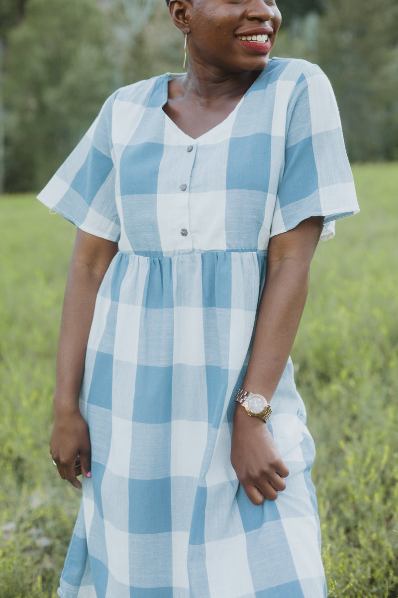 The Ethan Gingham Dress in Denim, lifestyle shoot; front view